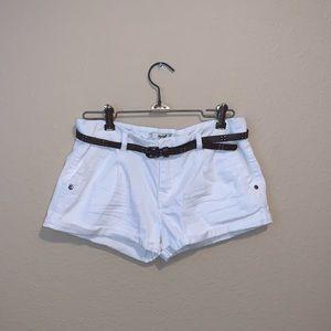 White denim shorts with brown belt